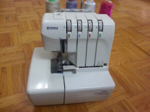 Kenmore 4 thrreads color coded serger like new