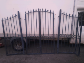 Heavy duty garden gates with side railings. Height over 2 metres