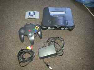 Nintendo 64 console with cords + game