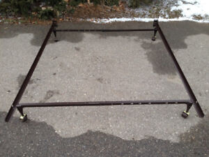 Queen adjustable bed frame, on wheels, has key slots so no hardw
