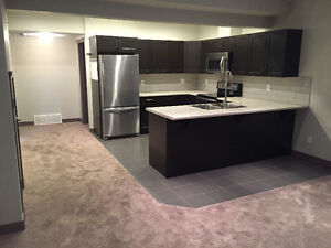 Basement Suite. Like New 975$ Utilities Included!