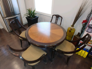 Solid wood dining table and 4 chairs with hand carving