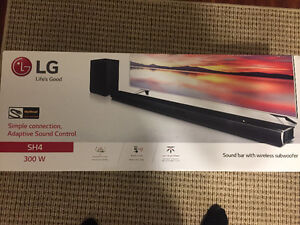New in box - Lg sound bar + wireless sub woofer