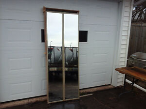 Mirrored bi-fold door with jam and hardware