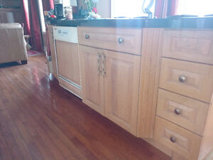 Complete kitchen cabinet set available  early september