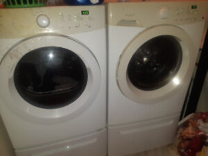 Front loading washer and dryer with pedelstools