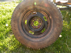 4 p215 75/r15 Winter Tires Mounted on Steel Rims for sale as is.