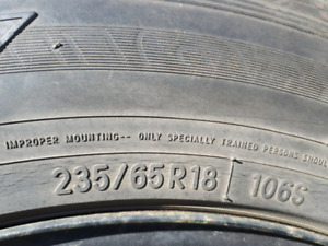 Like new  set of 4 snow tires TOYO 235/65/18