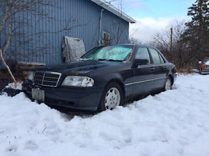 1995 Mercedes-Benz C-Class sedan and 1/2 Ton Chevy 4x4 and plow
