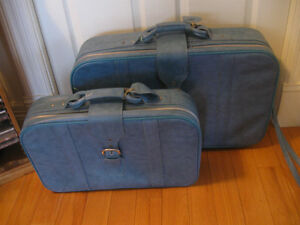TWO -PIECE SET of PULL-ALONG LUGGAGE on WHEELS