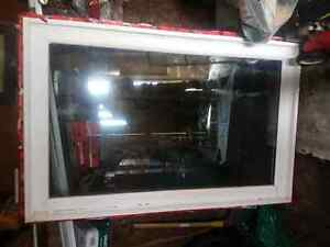 Selling four vinyl  windows