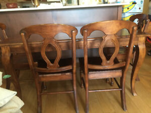 Beautiful hardwood dining room table  and chairs.