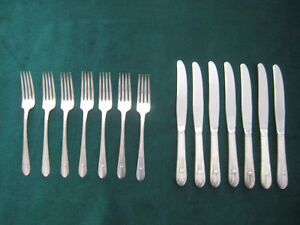 "WM. ROGERS SILVERWARE ""Sectional"" pattern forks & knives."