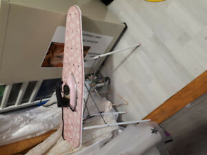 Antique toy iron and ironing board.   Iron heats up
