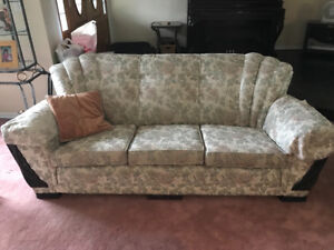 Couch with solid wood detail