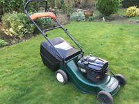 Self propelled petrol, lawnmower