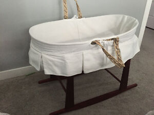 Jolly jumper baby Moses basket on rocking stand