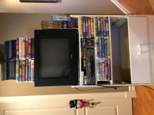 TV, VCR, stand and 61 movies