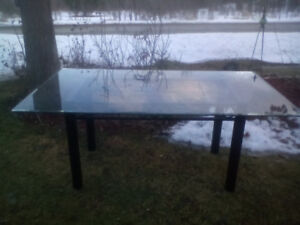 Glass table great for indoors or out