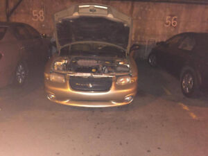 1999 Chryslers Sebring JXI Gold Berline