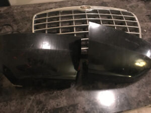 $75 tail lights and grill from a 2005 Chrysler 300c