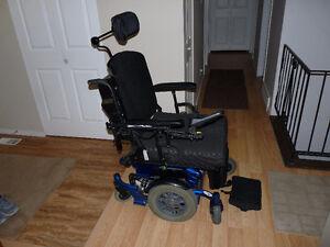 Heavy-duty electric wheel-chair for sale.