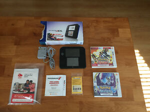 Nintendo 2DS + 2 Pokemon games and a free digital title!