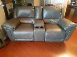 2 seat leather rocker recliner with center console  $800