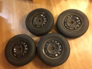 195/70R14 All season tires with rim and caps