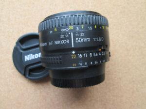 Lentille Nikon AF-D 50mm f1.8 avec extras
