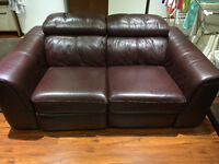 Two Leather Reclining Loveseat