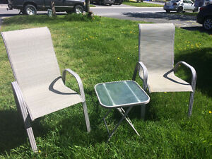 Two lawn chairs and side table