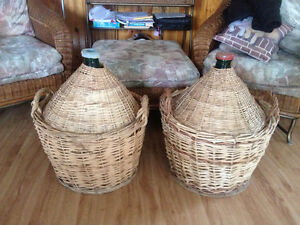 Two large antique Carboy's in wicker baskets. $40.00