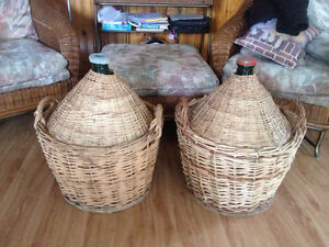 Two large antique Carboy's in wicker baskets. $50.00