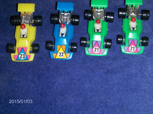 4 PLASTIC RACE CARS-MADE IN HONG KONG-1960/70S-COLLECTIBLE