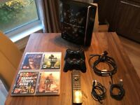 PS3 plus 4 games (console signed by Rockstar North crew)