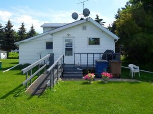 Large home on large lot only a short drive from Melfort!