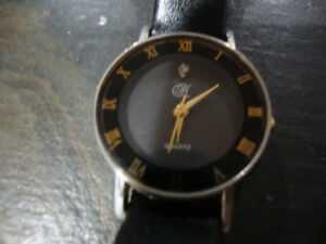 Woman's Black Face and Black Leather Band Dress Watch