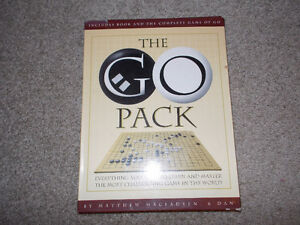 The Go Pack---Game of Go and book--pieces still sealed