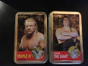 WWE Heritage Topps trading cards with tins