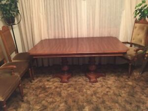Large dining room table and chairs for sale.
