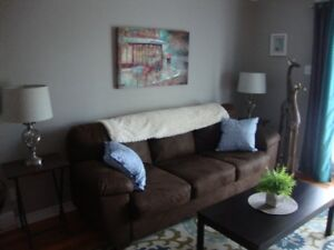 TASTEFULLY FURNISHED CONDO. DOWNTOWN LOCATION. A MUST SEE!!!