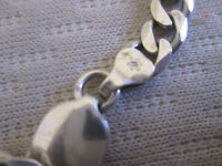 have silver chain and 2 collcetible rings and necklace