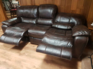 Faux leather double power recliner brown in color  300 dollars