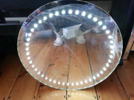 Round battery-operated LED bathroom mirror for sale. Unused