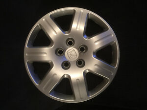 Honda original equipment hubcaps.