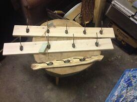Two wall mounted coat rails. One key hook holder