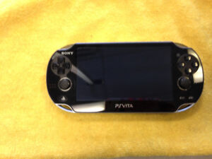 PSVITA with charger in case