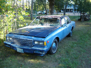 1986 CHEV/82 PONTIAC group sale.
