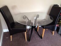 Glass Dining table and two free chairs